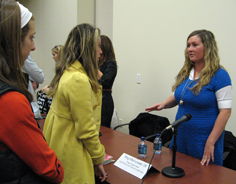 Students talk to an employer at a career fair