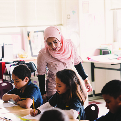 A Fairfield University student helping younger students learn