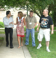 A group of graduate students walk and talk on Ender's Island.