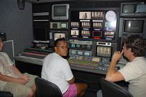 Students work behind the scenes for a television station.