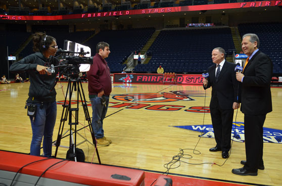 Fairfield U interns help out with an on court basketball interview.