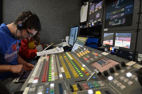 Fairfield U student working behind the scenes during a Stags sporting event.