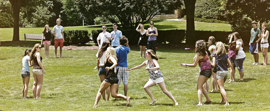 Image of Fairfield University students playing 'elbow tag' outside