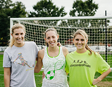 CAPTION: The women behind SoccerGrlProbs working at FAME, (L-R): Shannon Fay '14, Carly Beyar '14, and Alanna Locast '12.