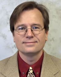 Image of faculty member, Christopher Huntley