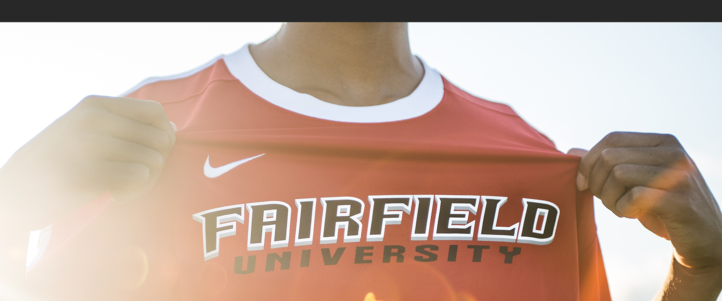 Fairfield University athlete showing off his jersey.
