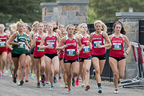 A large group of women's cross county athletes during an event