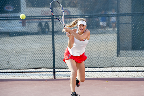 Women's tennis player returning a volley
