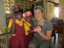 Student having fun with kids during her international trip to Jamaica