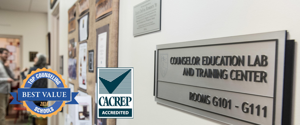 A plaque on the wall for the Counseling Education Lab and Training Center along with two logos - One for Best Value, Top Counseling Schools 2016 and the other for CACREP accredited.