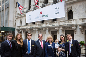 Parents at the entrance to the New York Stock Exchange