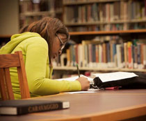 A student studying diligently in the library for an exam