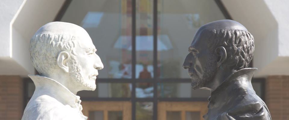 A shot of two contrasting statues on Fairfield's campus.