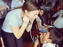 A Fairfield Undergraduate student playing with one of the children in Nicaragua.