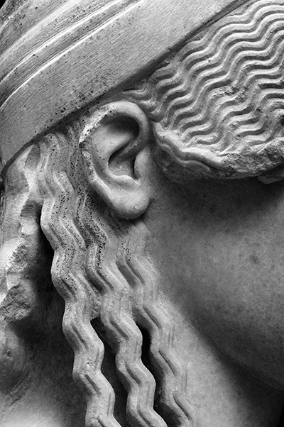 Close up of a statue showing the hair style details.