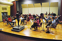 A group of Fairfield U students practice in the studio.