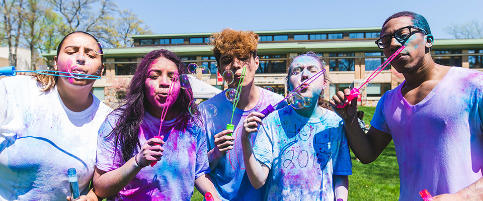 Students participating in an Indian Holi festival