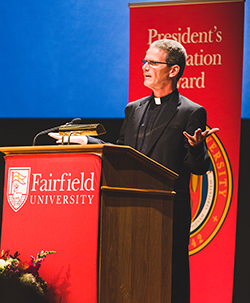 Rev. Michael Tunney, S.J., gives the Invocation at the second annual Fairfield University Convocation