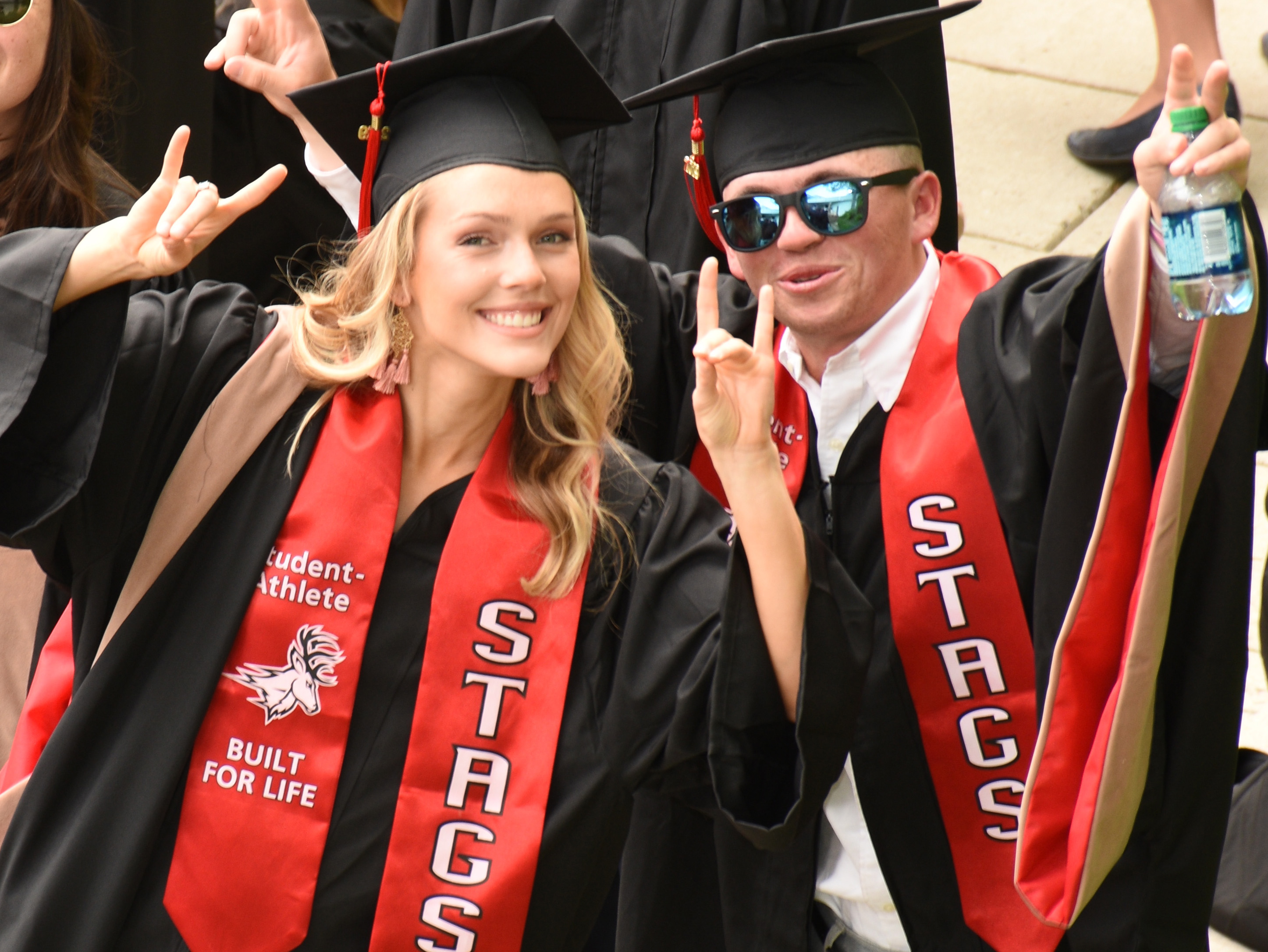Fairfield University Class of 2019 Stag graduates posing and smiling for the camera